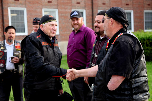 Dr. Bruce Heilman, left, 89, a World War II Marine veteran, greets Bill Watson of the Band of Brothers Motorcycle Club during his April 2015 visit to Marine Corps Base Quantico. (US Marine Corps/David White)