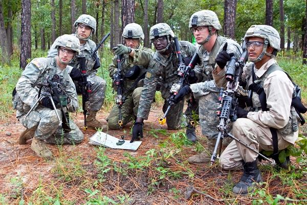 A soldier from Yemen (far right) and another from Greece (third from left) train alongside U.S. nfantry officer students on a dismounted patrol on Oct. 3, 2012, at Fort Eustis, Virginia. (Photo by Patrick A. Albright/U.S. Army)