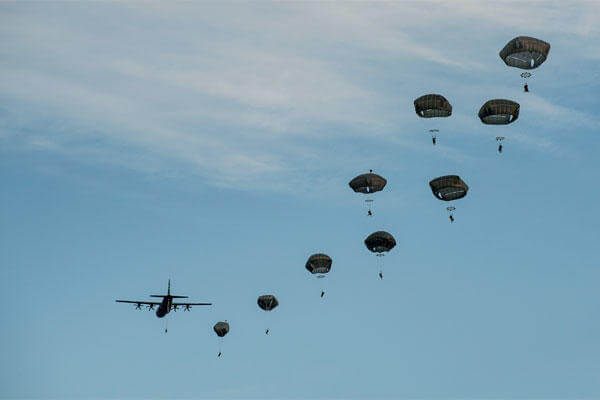 Paratroopers of the 18th Airborne Corps jump over Fort Campbell, Ky., during a warfighting exercise in November 2015. (US Army/Joel Salgado)
