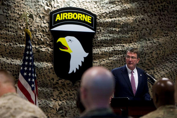 Defense Secretary Ash Carter speaks with service members during a troop event in Baghdad last July. (DoD photo/Tim Godbee)