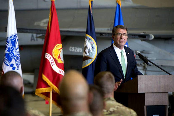 Defense Secretary Ash Carter speaks to troops at Bagram Airfield, Afghanistan, on July 12, 2016. He arrived in the country again on Dec. 9, unannounced. (DoD photo/Tim Godbee)