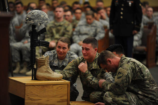 West Point cadets mourn the loss of their classmate, Mitchell Winey, at the conclusion of his memorial ceremony June 9 in the Spirit of Fort Hood Chapel. (US Army photo/Nicholas Conner)