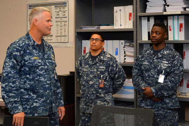 Rear Adm. Jon Kreitz (left) speaks with sailors during his May 2017 visit to Southeast Regional Maintenance Center (SERMC). The admiral was named deputy director of the Defense POW/MIA Accounting Agency. (Naval Sea Systems Command photo/Scott Curtis)