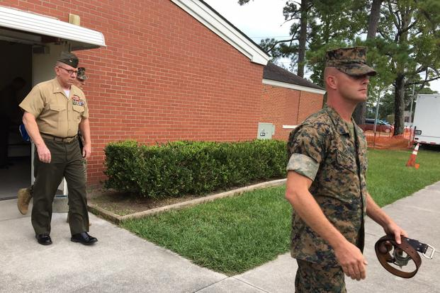 Col. Daniel Hunter Wilson, left, leaves the courtroom at Camp Lejeune, N.C., Sept. 9, 2017, after being found guilty of molesting a six-year-old girl. (Photo by Hope Hodge Seck/Military.com)