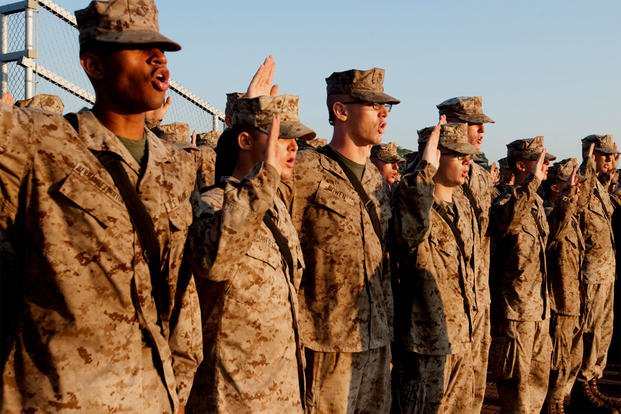Marine recruits renew their oath of enlistment at Marine Corps Recruit Depot Parris Island. One of the base's drill instructors is going on trial more than a year and a half after the suicide of a 20-year-old recruit. (US Marine Corps photo/MaryAnn Hill)