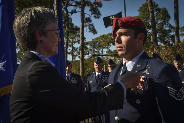 Air Force Secretary Heather Wilson pins the Air Force Cross on Staff Sgt. Richard Hunter, a Special Tactics Airman with the 23rd Special Tactics Squadron, during a ceremony Oct. 17, 2017, at Hurlburt Field, Fla. Senior Airman Ryan Conroy/Air Force