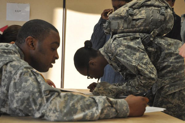 Soldiers sign out for leave.