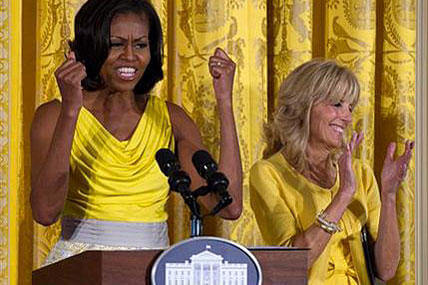 First lady Michelle Obama, accompanied by Jill Biden, speaks during a Joining Forces event in honor of military mothersin the East Room of the White House. AP Photo/Carolyn Kaster