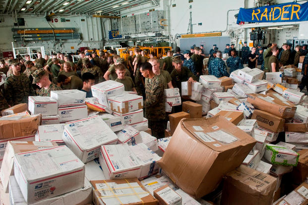 Sailors and Marines sort mail aboard the amphibious assault ship USS Makin Island (LHD 8). (U.S. Navy/Mass Communication Specialist 2nd Class Alan Gragg.)