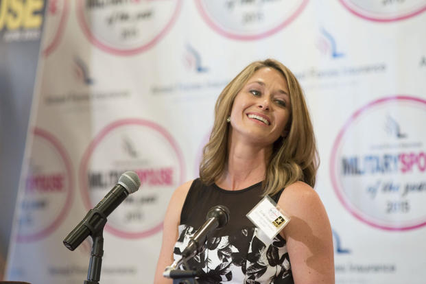 Corie Weathers gives remarks after receiving the 2015 Armed Forces Insurance Military Spouse of the Year award at the Military Spouse of the Year ceremony (Photo: U.S. Army/Damien Salas)