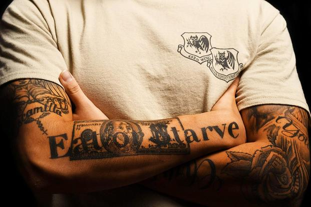 Senior Airman DelAngel, 432nd Wing administration journeyman, displays his tattoos at Creech Air Force Base, Nev. (U.S. Air Force photo by Airman 1st Class James Thompson)