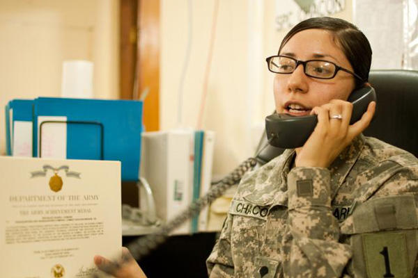 Army HR phone call at a desk.