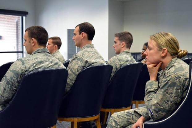 Service members attending a meeting.