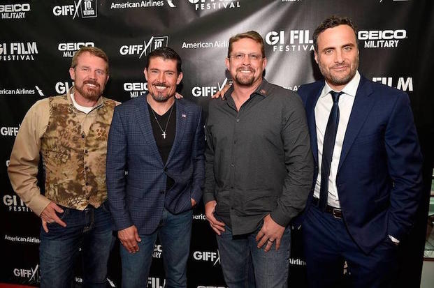 "Mark Oz Geist, Kris Tanto"" Paronto, John Tig Tiegen, & Dominic Fumosa photographed on the red carpet at the G.I. Film Festival screening of ""13 Hours: The Secret Soldiers of Benghazi"" on May 29, 2016."