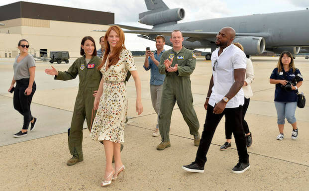 The Magnificent 7 director Antoine Fuqua (right) walks with movie actress Haley Bennett (2nd,left) as they are escorted by USAF Col. Darren R. Cole (center,background) and USAF Lt. Col. Jannell Macaulay (left) during a visit to a KC-10 tanker prior to a USO-sponsored film premiere at Joint Base McGuire-Dix-Lakehurst, New Jersey, September 18, 2016. The cast members and director toured the flightline, greeted service members and met with military families to extend their appreciation for their service. USO P