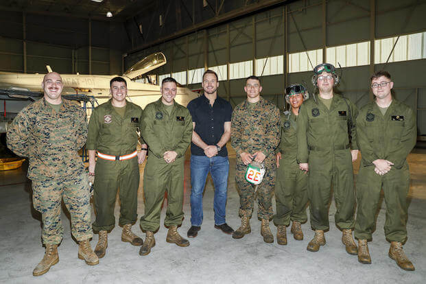 SAN DIEGO, CA - DECEMBER 12: Actor Chris Pratt (C) poses with U.S. Marines at Marine Corps Air Station Miramar on December 12, 2016 in San Diego, California. (Photo by Rich Polk/Getty Images for Sony Pictures Entertainment )