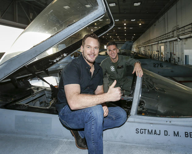 SAN DIEGO, CA - DECEMBER 12: Actor Chris Pratt poses with a U.S. Marine at Marine Corps Air Station Miramar on December 12, 2016 in San Diego, California.
