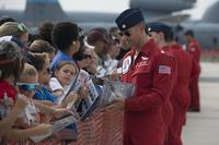 Lt. Col. Jason Heard of the U.S. Air Force Thunderbirds Air Demonstration Squadron and pilot of the No. 1 jet, signs autographs after completing a performance Aug. 27, 2017, at Dover Air Force Base, Del. (U.S. Air Force/Zachary Cacicia)