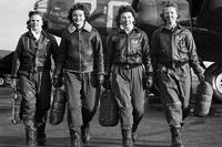 "Women Airforce Service pilots Frances Green, Margaret ""Peg"" Kirchner, Ann Waldner and Blanche Osborn, leave their B-17 Flying Fortress aircraft, ""Pistol Packin' Mama,"" during ferry training at Lockbourne Army Airfield, Ohio, 1944. (U.S. Air Force)"