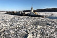 Coast Guard Cutter Penobscot Bay helps break free tug Brooklyn from the ice on the Hudson River near Saugerties, New York, December, 31 2017. (U.S. Coast Guard photo)