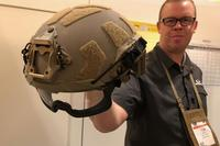 Tom Short of Gentex holds the company's new Fast SF helmet at SHOT Show 2018. (Hope Hodge Seck/Military.com)