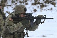 Cpl. Nicholas Carey fires an M4 Carbine during Close Quarter Marksmanship training in Rukla, Lithuania, Jan. 24, 2017.