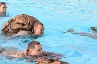 Lance Cpl. Charles Melber, an armory custodian with 9th Communication Battalion, I Marine Expeditionary Force, swims while wearing a full pack during swim qualification at Camp Pendleton, Calif., April 4. (U.S. Marine Corps/Cpl. Joshua Young)