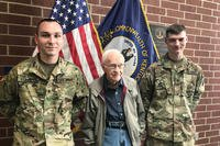 Spc. Justin Stinnett (left) and Spc. Casey Brandle (far right) share a photo op with David Hamilton in Owensboro, Ky., March 19, 2018. Stinnett and Brandle are credited with saving Hamilton from an auto accident in flood waters in Owensboro Feb. 27. (U.S. Army National Guard photo/ Brooklynd Decker)