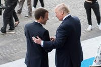 French President Emmanuel Macron welcomes President Donald Trump to the reviewing stand for the Bastille Day military parade in Paris, July 14, 2017. (DoD photo/Dominique Pineiro)