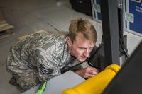 Staff Sgt. Ryan Hoagland, 96th Civil Engineer Group, makes adjustments to gripping arms during the assembly of the explosive ordnance disposal flight's new robot April 9 at Eglin Air Force Base, Fla. (U.S. Air Force/Ilka Cole)