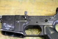 The receiver of a former M4 carbine shows laser etching to reflect it is now an M4A1 capable of firing on full-auto. (U.S. Army)