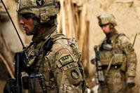 Soldiers of the 2nd Brigade, 34th Infantry Division move through a compound during a search for Taliban in Qual-e Jala, Afghanistan, in March 2011. (US Army photo/Ashlee Lolkus)