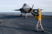 "Chief Aviation Boatswain's Mate (Handling) Araseli Morales directs an F-35B Lightning II assigned to the ""Avengers"" of Marine Fighter Attack Squadron (VMFA) 211 on the flight deck of the Wasp-class amphibious assault ship USS Essex (LHD 2), March 5, 2018. (U.S. Navy photo/Chandler Harrell)"