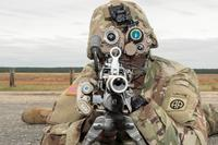 Spec. Shykeen McClellan, a soldier with the 82nd Airborne Division, conducts post drop systems check of the Family of Weapons Sights-Individual (FWS-I), mounted to the M-249 squad automatic weapon after landing on Fort Bragg, N.C.'s Sicily Drop Zone. (Photo: U.S. Army)