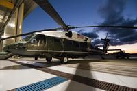 A VH-60 helicopter belonging to Marine Helicopter Squadron One in Quantico, Virginia appears in a hangar in 2014. (Marine Corps photo)
