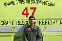 Lance Cpl. Matthew Buenrostro poses for a photo July 16 at Ie Shima Training Facility. The Crash Fire Rescue Marines rushed to the aid of Ie Village Firefighters when they needed assistance extinguishing a farm fire. Buenostro, a Los Angeles, California, native, is an aircraft rescue and firefighting specialist with Marine Wing Support Squadron 172, Marine Aircraft Group 36, 1st Marine Aircraft Wing. (Photo courtesy of 1st Lt. Christine Baldridge)