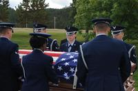 Airmen from the Ellsworth Air Force Base's Honor Guard move the casket of a retiree during a funeral at Black Hills National Cemetery in Sturgis, S.D., Sept. 26, 2017. (U.S. Air Force/Airman Nicolas Z. Erwin)