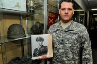In this 2015 photo, Staff Sgt. Joshua Conner holds a photograph of his relative, 1st Lt. Garlin Murl Conner. According to various news reports, Lt. Conner was the second most- decorated soldier who fought in World War II. (US Army photo/David Lietz)