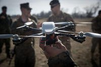A Marine holds up an MK-2 Instant Eye quadcopter unmanned aerial system during exercise Spring Storm 2018, Capu Midia Training Area, Romania, March 10, 2018. (U.S. Marine Corps photo/Austin Livingston)