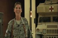 A screenshot from a 2011 video shot in Kandahar, Afghanistan shows then-Navy Cmdr. Lynne Blankenbeker sending Christmas greetings to family back home. Blankenbeker is now running for Congress in New Hampshire. (DVIDS)