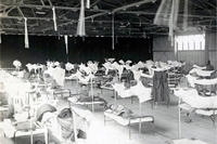 "Soldiers fill a makeshift hospital at Camp Upton, Long Island during the influenza epidemic in the fall of 1918. More than 6,100 Soldiers contracted the so-called ""Spanish Flu"" at Camp Upton in September and October 1918 and 404 died during the pandemic. (Photo: National Archives)"