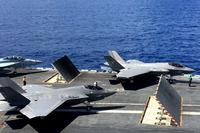 Two F-35Cs and a F/A-18 sit on the flight deck of the carrier USS Abraham Lincoln (CVN-72) on August 27, 2018. (Military.com/Matthew Cox)