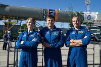 From left, future International Space Station crew members Army Astronaut Lt. Col. Anne McClain, with U.S. Army Space and Missile Defense Command/Army Forces Strategic Command; Oleg Kononenko, with the Russian space agency Roscosmos; and David Saint-Jacques, with the Canadian Space Agency, pose for a picture as a Soyuz rocket arrives at the launch pad June 4, 2018, at the Baikonur Cosmodrome in Kazakhstan. (U.S. Army photo)