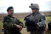 Staff Sgt. Nicholas Ives of the Georgia National Guard, right, and Capt. Mohammad Ali Yazdani discuss the progress of the Afghan National Army's efforts. (US Army photo/Christopher DeWitt)