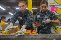 Sailors sort donated food during a community relations event at the Los Angeles Regional Food Bank during Los Angeles Fleet Week, 2018. (U.S. Navy/Danielle Baker)