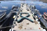 Crew members assigned to the USS North Dakota and USS Virginia form in the shape of a teal-colored ribbon on Wednesday, April 11, 2018, at Naval Submarine Base, New London to support Sexual Assault Awareness and Prevention Month. (U.S. Navy/Christian Porter)