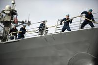 Sailors heave a mooring line aboard the Arleigh Burke-class guided-missile destroyer USS Preble (DDG 88) as it departs Naval Base San Diego for a scheduled underway. (U.S. Navy/Mass Communication Specialist 3rd Class Carlos M. Vazquez II)