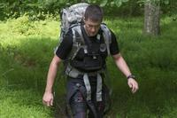 A Soldier wears an exosuit while on a three-mile outdoor course at a U.S. Army Research Laboratory facility at Aberdeen Proving Ground, Maryland. (U.S. Army/Rob Carty)