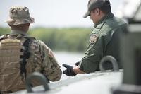 A Texas Guardsman and a Customs and Border Patrol agent discuss the lay of the land April 10, 2018 on the shores of the Rio Grande River in Starr County, Texas. (Texas Military Department/Sgt. Mark Otte)