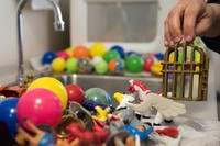 Soha Dobbins, a Children's Waiting Room child specialist, washes toys used in the Children's Waiting Room at Joint Base Elmendorf-Richardson, Alaska. (U.S. Air Force/Crystal A. Jenkins)